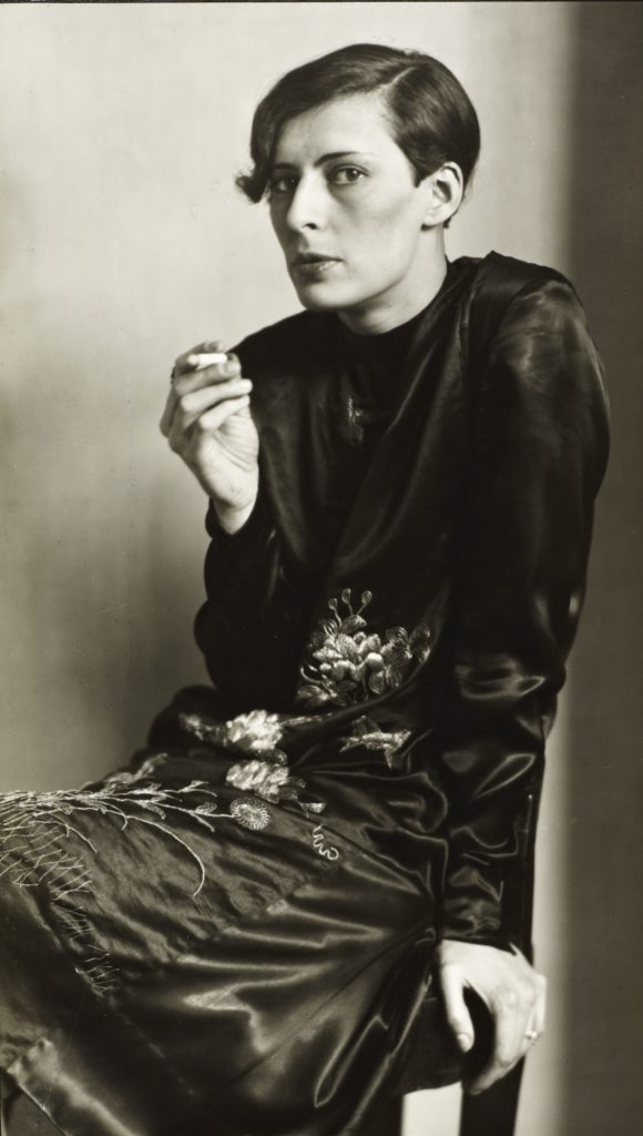August Sander's portrait of a secretary in Cologne 1931 smoking a cigarette is part of our round-up of must-see photography in October 2019
