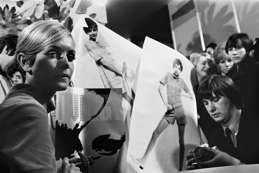 A portrait of Twiggy with the press in London, 1960, by Marilyn Stafford