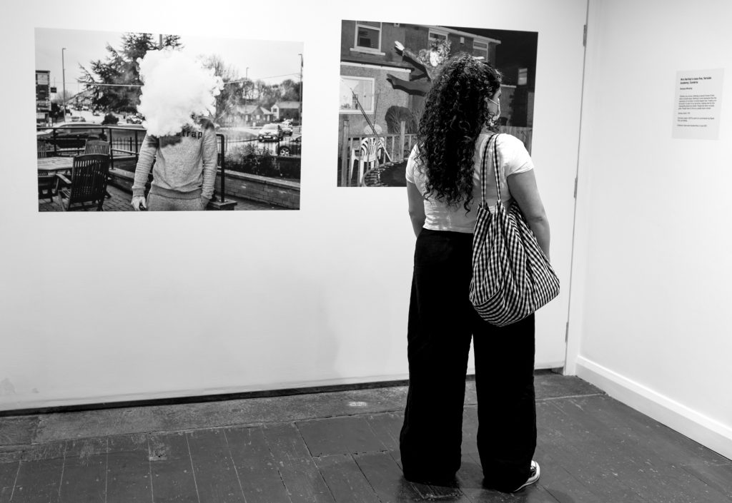 A gallery visitor views the Youth Rising in the UK 1981-2021 exhibition